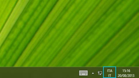 Pulsante con l'abbreviazione della lingua sulla barra delle applicazioni del desktop
