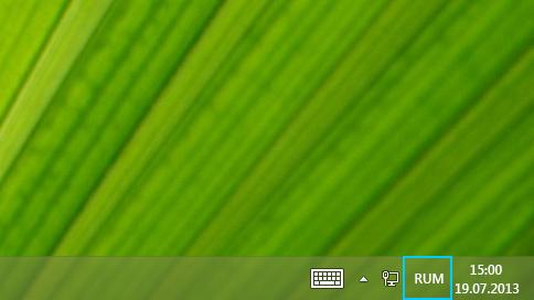 Butonul cu abrevierea limbii din bara de activități de pe desktop