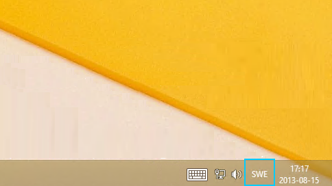 Knappen med språkförkortningen i Aktivitetsfältet på skrivbordet